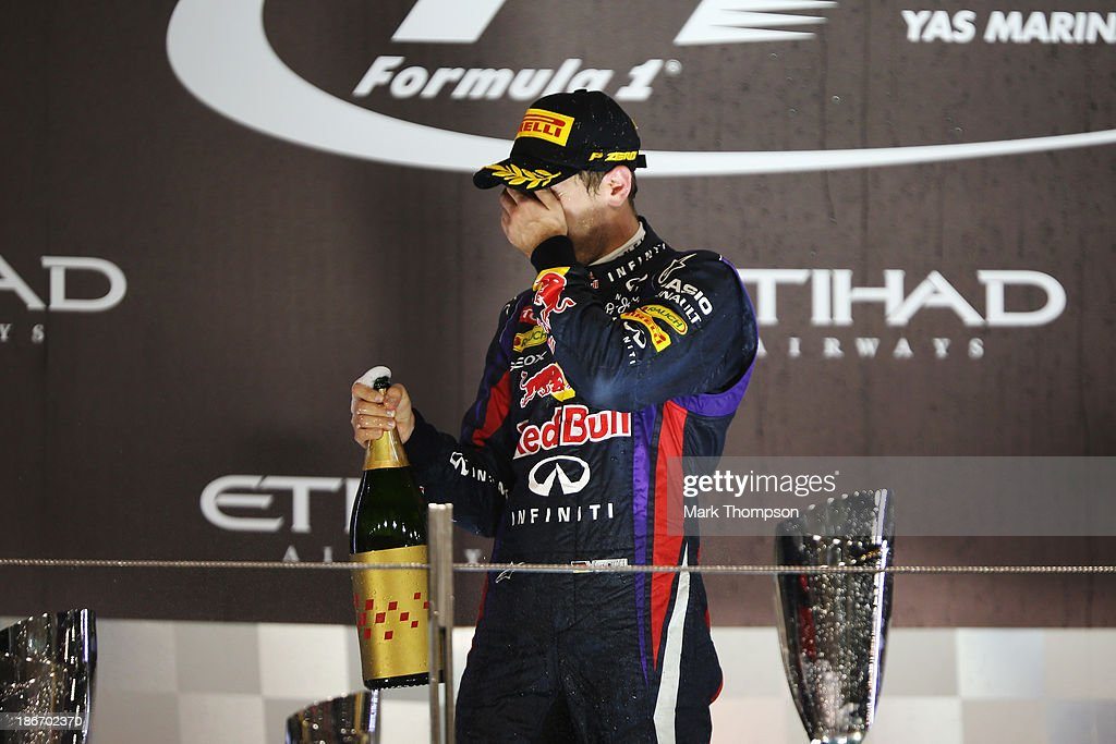 <a gi-track='captionPersonalityLinkClicked' href=/galleries/search?phrase=Sebastian+Vettel&family=editorial&specificpeople=2233605 ng-click='$event.stopPropagation()'>Sebastian Vettel</a> of Germany and Infiniti Red Bull Racing celebrates on the podium after winning the Abu Dhabi Formula One Grand Prix at the Yas Marina Circuit on November 3, 2013 in Abu Dhabi, United Arab Emirates.