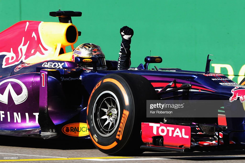 Sebastian Vettel of Germany and Infiniti Red Bull Racing celebrates as he crosses the finish line to win the United States Formula One Grand Prix at...