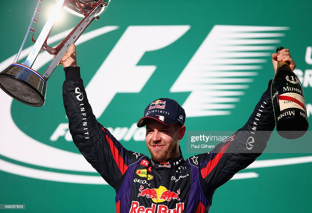 <a gi-track='captionPersonalityLinkClicked' href=/galleries/search?phrase=Sebastian+Vettel&family=editorial&specificpeople=2233605 ng-click='$event.stopPropagation()'>Sebastian Vettel</a> of Germany and Infiniti Red Bull Racing celebrates on the podium after winning the United States Formula One Grand Prix at Circuit of The Americas on November 17, 2013 in Austin, United States.