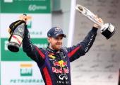 Sebastian Vettel of Germany and Infiniti Red Bull Racing celebrates on the podium after winning the Brazilian Formula One Grand Prix at Autodromo...