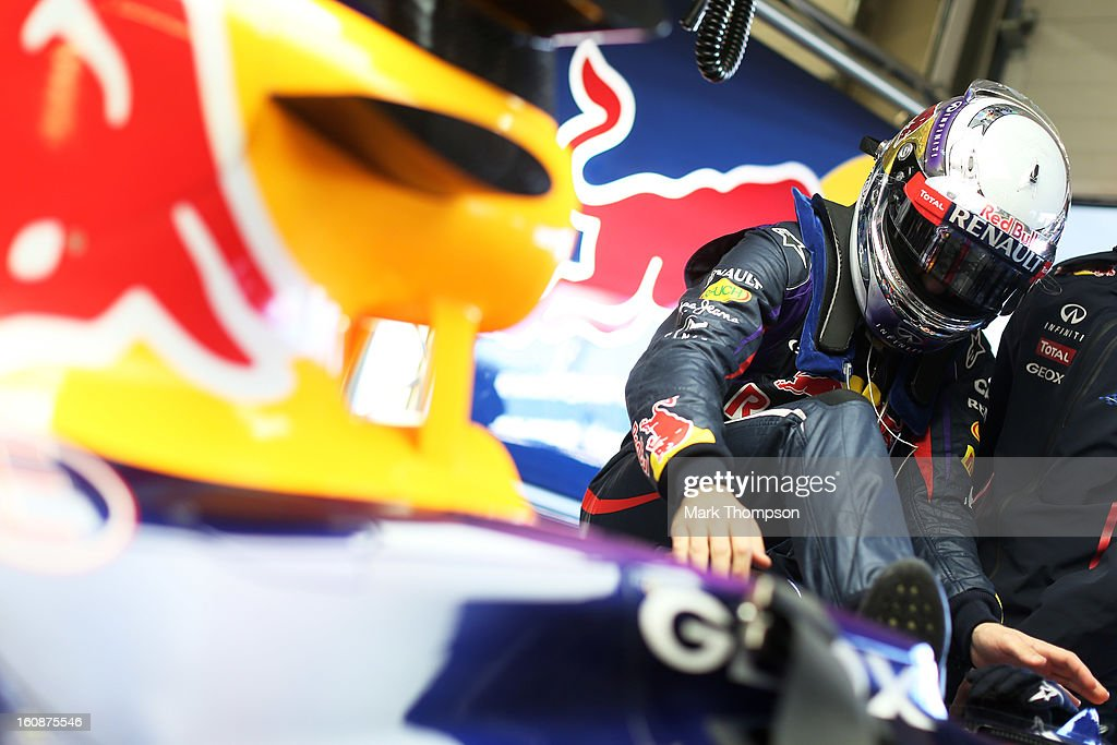 Sebastian Vettel of Germany and Infiniti Red Bull Racing climbs into his car during Formula One winter testing at Circuito de Jerez on February 7, 2013 in Jerez de la Frontera, Spain.