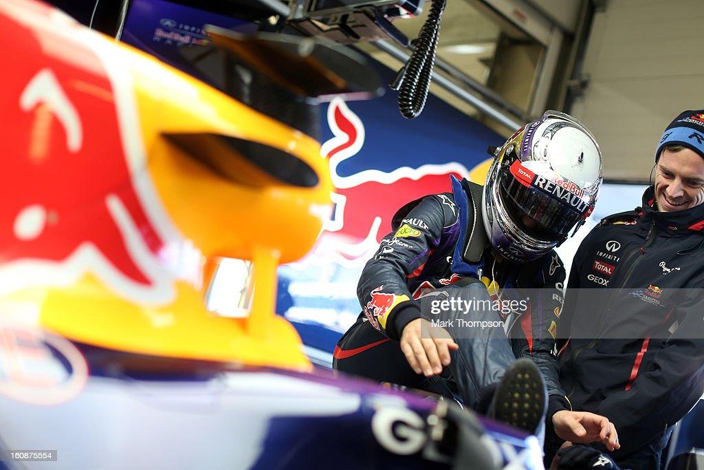 Sebastian Vettel of Germany and Infiniti Red Bull Racing climbs into his car during Formula One winter testing at Circuito de Jerez on February 7, 2013 in Jerez de la Frontera, Spain.