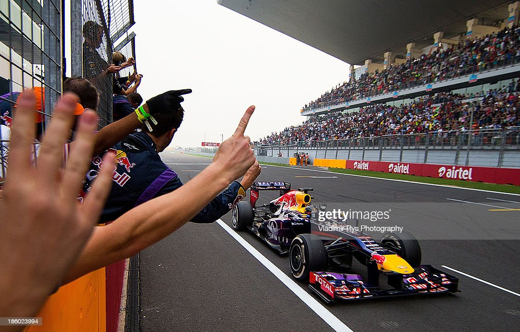 Sebastian Vettel of Germany and Infiniti Red Bull Racing crosses the finish line to win the Indian Formula One Grand Prix at Buddh International Circuit on October 27, 2013 in Noida, India.