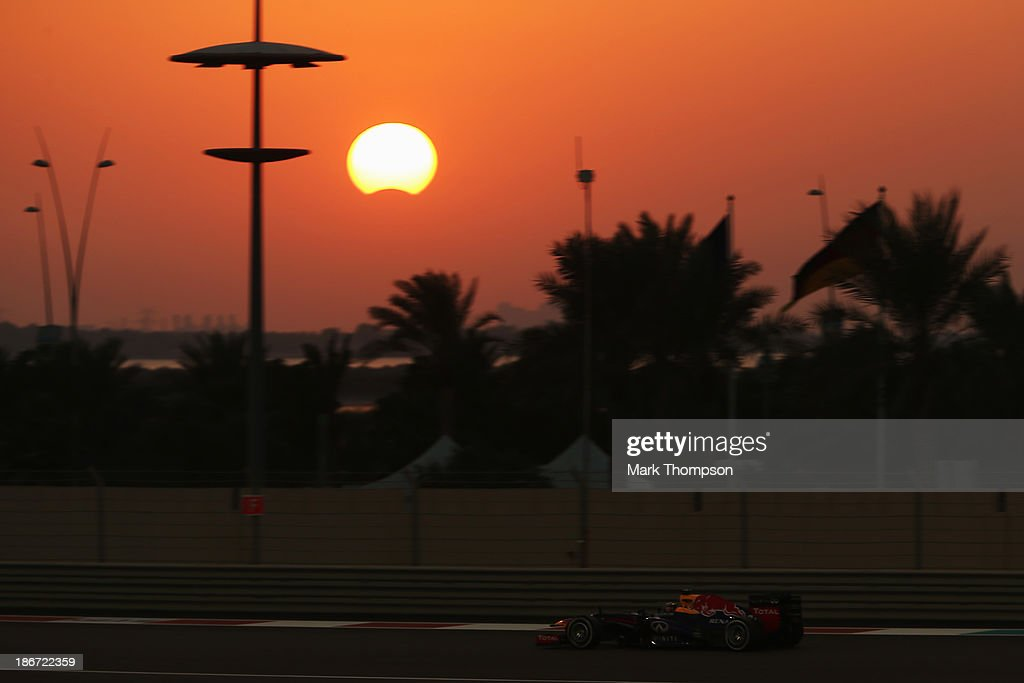 <a gi-track='captionPersonalityLinkClicked' href=/galleries/search?phrase=Sebastian+Vettel&family=editorial&specificpeople=2233605 ng-click='$event.stopPropagation()'>Sebastian Vettel</a> of Germany and Infiniti Red Bull Racing drives as a rare hybrid solar eclipse takes place during the Abu Dhabi Formula One Grand Prix at the Yas Marina Circuit on November 3, 2013 in Abu Dhabi, United Arab Emirates.