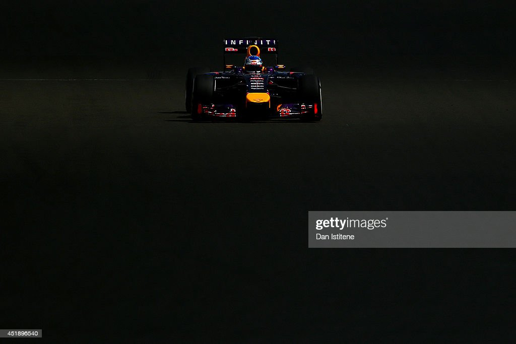 <a gi-track='captionPersonalityLinkClicked' href=/galleries/search?phrase=Sebastian+Vettel&family=editorial&specificpeople=2233605 ng-click='$event.stopPropagation()'>Sebastian Vettel</a> of Germany and Infiniti Red Bull Racing drives during day two of testing at Silverstone Circuit on July 9, 2014 in Northampton, England.