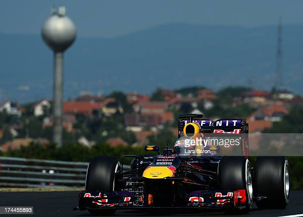 Sebastian Vettel of Germany and Infiniti Red Bull Racing drives during practice for the Hungarian Formula One Grand Prix at Hungaroring on July 26...