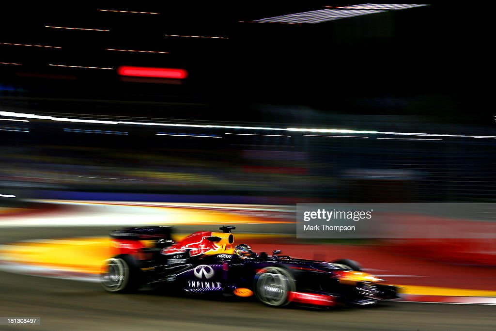 <a gi-track='captionPersonalityLinkClicked' href=/galleries/search?phrase=Sebastian+Vettel&family=editorial&specificpeople=2233605 ng-click='$event.stopPropagation()'>Sebastian Vettel</a> of Germany and Infiniti Red Bull racing drives during practice for the Singapore Formula One Grand Prix at Marina Bay Street Circuit on September 20, 2013 in Singapore, Singapore.