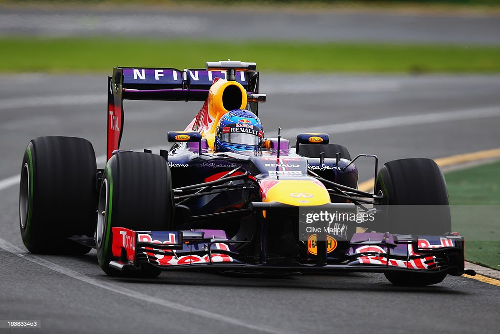 <a gi-track='captionPersonalityLinkClicked' href=/galleries/search?phrase=Sebastian+Vettel&family=editorial&specificpeople=2233605 ng-click='$event.stopPropagation()'>Sebastian Vettel</a> of Germany and Infiniti Red Bull Racing drives on his way to finishing first during the weather delayed qualifying session for the Australian Formula One Grand Prix at the Albert Park Circuit on March 17, 2013 in Melbourne, Australia.