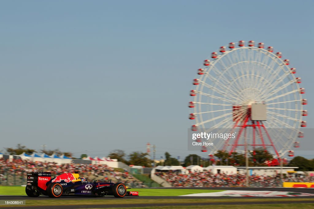 Sebastian Vettel of Germany and Infiniti Red Bull Racing drives on his way to winning the Japanese Formula One Grand Prix at Suzuka Circuit on...