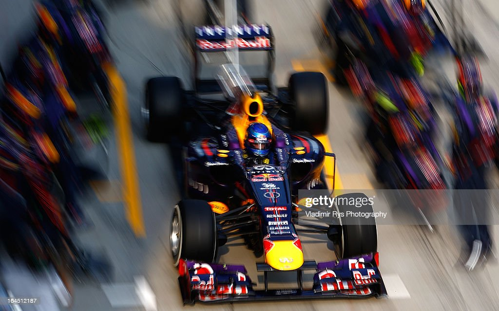 Sebastian Vettel of Germany and Infiniti Red Bull Racing drives out after a pitstop during the Malaysian Formula One Grand Prix at Sepang International Circuit on March 24, 2013 in Kuala Lumpur, Malaysia.