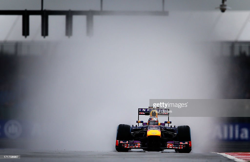 <a gi-track='captionPersonalityLinkClicked' href=/galleries/search?phrase=Sebastian+Vettel&family=editorial&specificpeople=2233605 ng-click='$event.stopPropagation()'>Sebastian Vettel</a> of Germany and Infiniti Red Bull Racing drives during the rain affected practice session for the British Formula One Grand Prix at Silverstone Circuit on June 28, 2013 in Northampton, England.