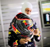Sebastian Vettel of Germany and Infiniti Red Bull Racing holds his race helmet which has been customised in celebration of the German national...