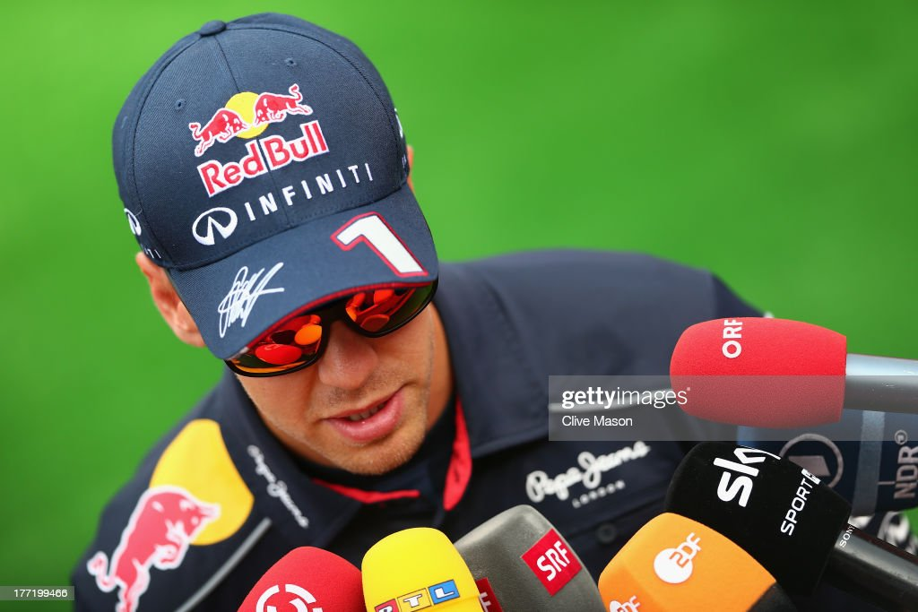 <a gi-track='captionPersonalityLinkClicked' href=/galleries/search?phrase=Sebastian+Vettel&family=editorial&specificpeople=2233605 ng-click='$event.stopPropagation()'>Sebastian Vettel</a> of Germany and Infiniti Red Bull Racing is interviewed by the media during previews to the Belgian Grand Prix at Circuit de Spa-Francorchamps on August 22, 2013 in Spa, Belgium.