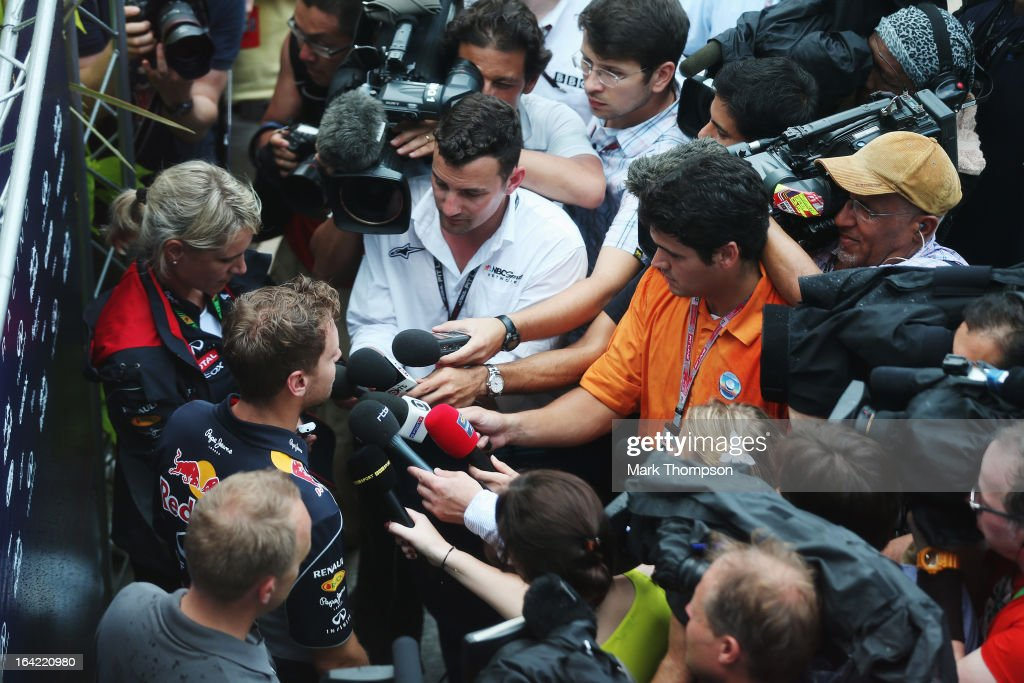 Sebastian Vettel of Germany and Infiniti Red Bull Racing is interviewed in the paddock during previews to the Malaysian Formula One Grand Prix at the Sepang Circuit on March 21, 2013 in Kuala Lumpur, Malaysia.