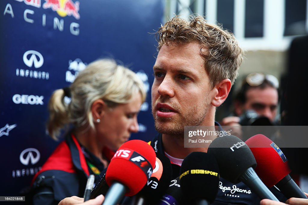 <a gi-track='captionPersonalityLinkClicked' href=/galleries/search?phrase=Sebastian+Vettel&family=editorial&specificpeople=2233605 ng-click='$event.stopPropagation()'>Sebastian Vettel</a> of Germany and Infiniti Red Bull Racing is interviewed in the paddock during previews to the Malaysian Formula One Grand Prix at the Sepang Circuit on March 21, 2013 in Kuala Lumpur, Malaysia.