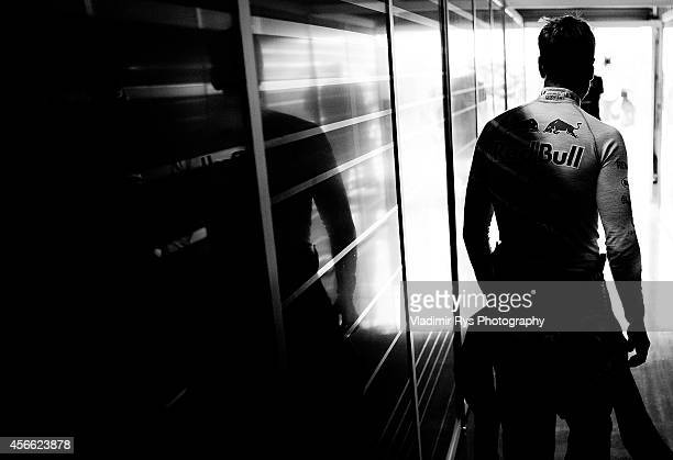 Sebastian Vettel of Germany and Infiniti Red Bull Racing is pictured in his garage following the practice prior qualifying for the Japanese Formula...