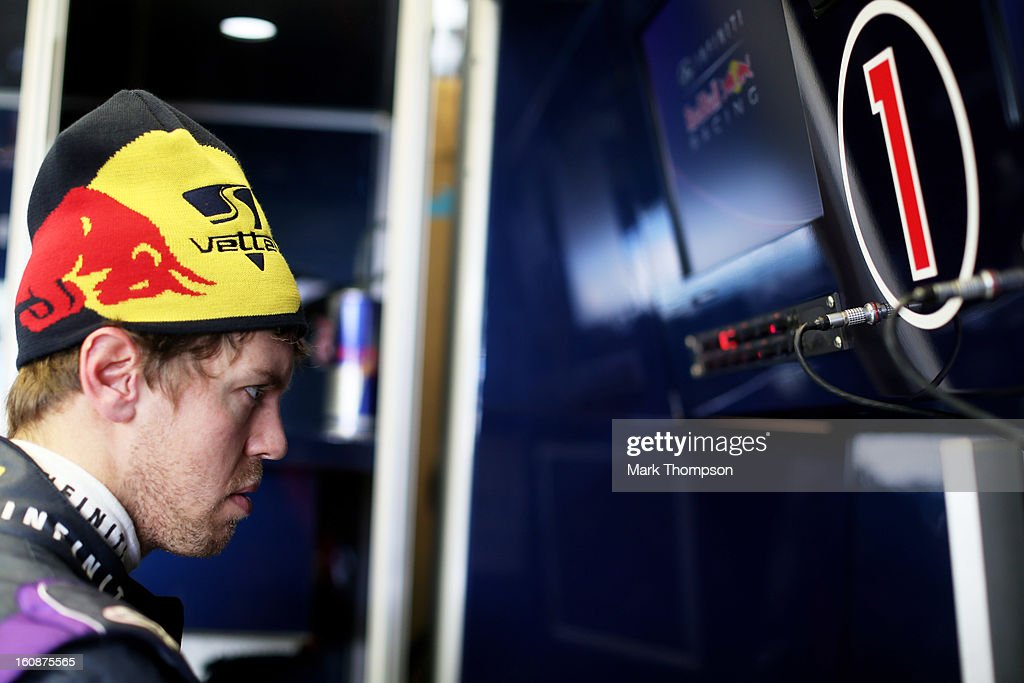 Sebastian Vettel of Germany and Infiniti Red Bull Racing is seen in the team garage during Formula One winter testing at Circuito de Jerez on February 7, 2013 in Jerez de la Frontera, Spain.
