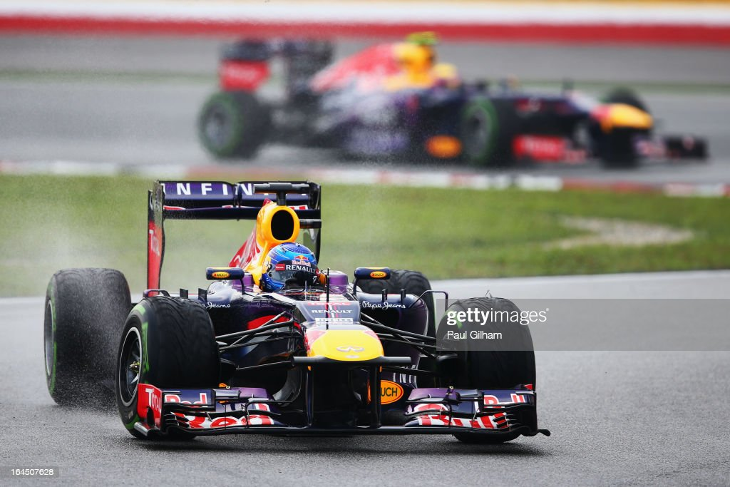 Sebastian Vettel of Germany and Infiniti Red Bull Racing leads from team mate Mark Webber of Australia and Infiniti Red Bull Racing during the Malaysian Formula One Grand Prix at the Sepang Circuit on March 24, 2013 in Kuala Lumpur, Malaysia.