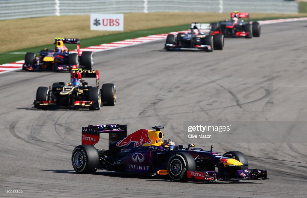 <a gi-track='captionPersonalityLinkClicked' href=/galleries/search?phrase=Sebastian+Vettel&family=editorial&specificpeople=2233605 ng-click='$event.stopPropagation()'>Sebastian Vettel</a> of Germany and Infiniti Red Bull Racing leads from <a gi-track='captionPersonalityLinkClicked' href=/galleries/search?phrase=Romain+Grosjean&family=editorial&specificpeople=4858519 ng-click='$event.stopPropagation()'>Romain Grosjean</a> of France and Lotus and <a gi-track='captionPersonalityLinkClicked' href=/galleries/search?phrase=Mark+Webber+-+Race+Car+Driver&family=editorial&specificpeople=167271 ng-click='$event.stopPropagation()'>Mark Webber</a> of Australia and Infiniti Red Bull Racing during the United States Formula One Grand Prix at Circuit of The Americas on November 17, 2013 in Austin, United States.