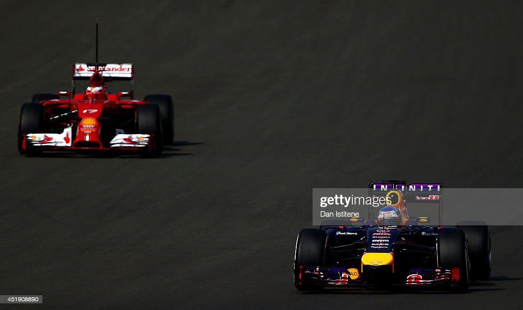 Sebastian Vettel of Germany and Infiniti Red Bull Racing leads Jules Bianchi of France driving a Ferrari during day two of testing at Silverstone Circuit on July 9, 2014 in Northampton, England.