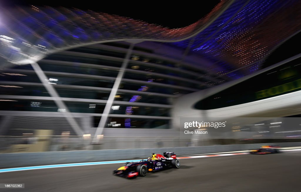 <a gi-track='captionPersonalityLinkClicked' href=/galleries/search?phrase=Sebastian+Vettel&family=editorial&specificpeople=2233605 ng-click='$event.stopPropagation()'>Sebastian Vettel</a> of Germany and Infiniti Red Bull Racing leads team mate <a gi-track='captionPersonalityLinkClicked' href=/galleries/search?phrase=Mark+Webber+-+Race+Car+Driver&family=editorial&specificpeople=167271 ng-click='$event.stopPropagation()'>Mark Webber</a> of Australia and Infiniti Red Bull Racing on the cool down lap after winning the Abu Dhabi Formula One Grand Prix at the Yas Marina Circuit on November 3, 2013 in Abu Dhabi, United Arab Emirates.