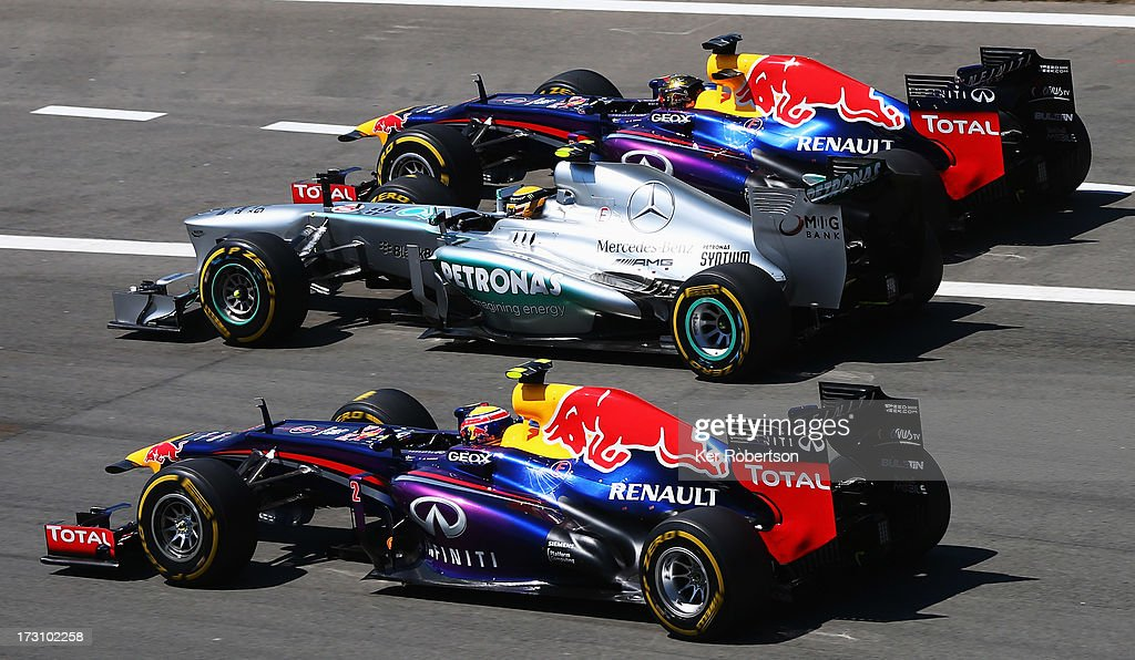 <a gi-track='captionPersonalityLinkClicked' href=/galleries/search?phrase=Sebastian+Vettel&family=editorial&specificpeople=2233605 ng-click='$event.stopPropagation()'>Sebastian Vettel</a> (top) of Germany and Infiniti Red Bull Racing, <a gi-track='captionPersonalityLinkClicked' href=/galleries/search?phrase=Lewis+Hamilton&family=editorial&specificpeople=586983 ng-click='$event.stopPropagation()'>Lewis Hamilton</a> (middle) of Great Britain and Mercedes GP and <a gi-track='captionPersonalityLinkClicked' href=/galleries/search?phrase=Mark+Webber+-+Piloto+de+automobilismo&family=editorial&specificpeople=167271 ng-click='$event.stopPropagation()'>Mark Webber</a> (bottom) of Australia and Infiniti Red Bull Racing drive side by side into the first corner at the start of the German Grand Prix at the Nuerburgring on July 7, 2013 in Nuerburg, Germany.