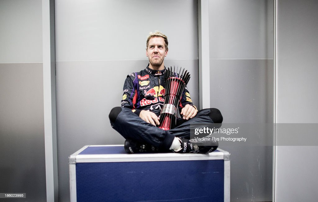 <a gi-track='captionPersonalityLinkClicked' href=/galleries/search?phrase=Sebastian+Vettel&family=editorial&specificpeople=2233605 ng-click='$event.stopPropagation()'>Sebastian Vettel</a> of Germany and Infiniti Red Bull Racing poses for a photo in his changing room after winning the Indian Formula One Grand Prix at Buddh International Circuit on October 27, 2013 in Noida, India.