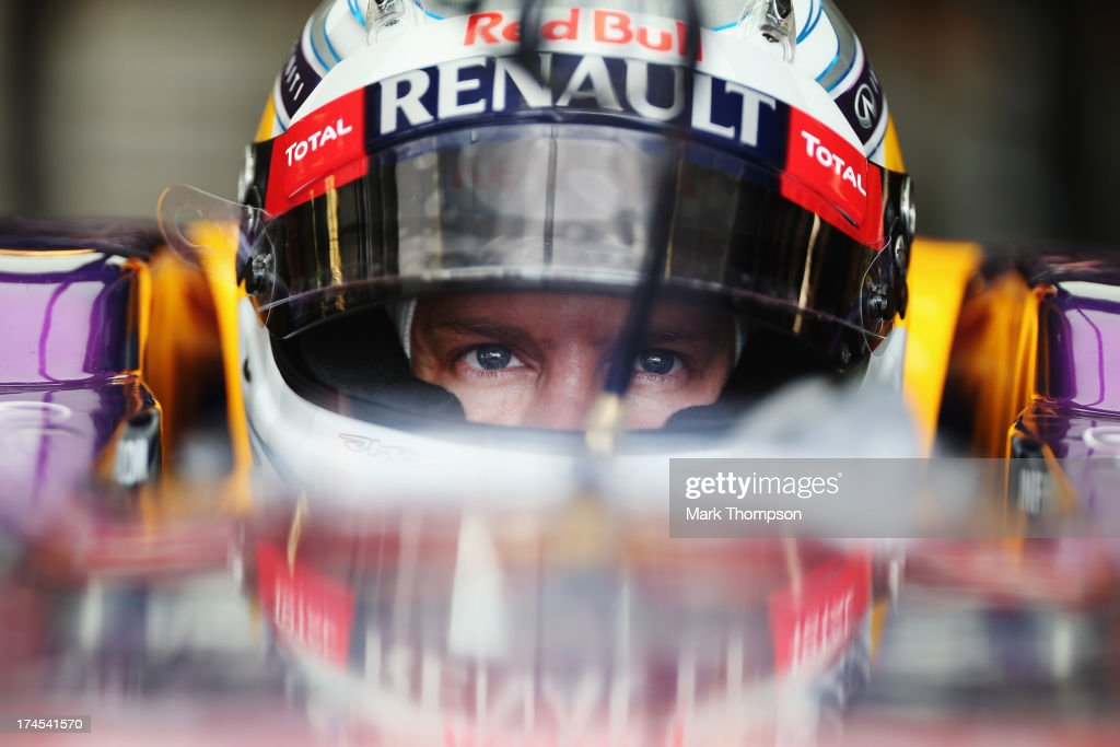 <a gi-track='captionPersonalityLinkClicked' href=/galleries/search?phrase=Sebastian+Vettel&family=editorial&specificpeople=2233605 ng-click='$event.stopPropagation()'>Sebastian Vettel</a> of Germany and Infiniti Red Bull Racing prepares to drive during qualifying for the Hungarian Formula One Grand Prix at Hungaroring on July 27, 2013 in Budapest, Hungary.