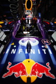 Sebastian Vettel of Germany and Infiniti Red Bull Racing prepares to drive during qualifying for the United States Formula One Grand Prix at Circuit...