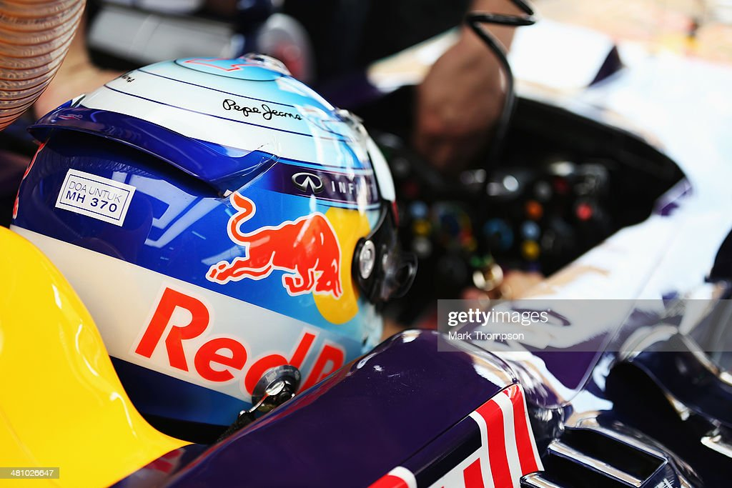 Sebastian Vettel of Germany and Infiniti Red Bull Racing prepares to drive while wearing an inscription on his helmet in memory of Malaysian Airlines flight MH370 during practice for the Malaysia Formula One Grand Prix at the Sepang Circuit on March 28, 2014 in Kuala Lumpur, Malaysia.