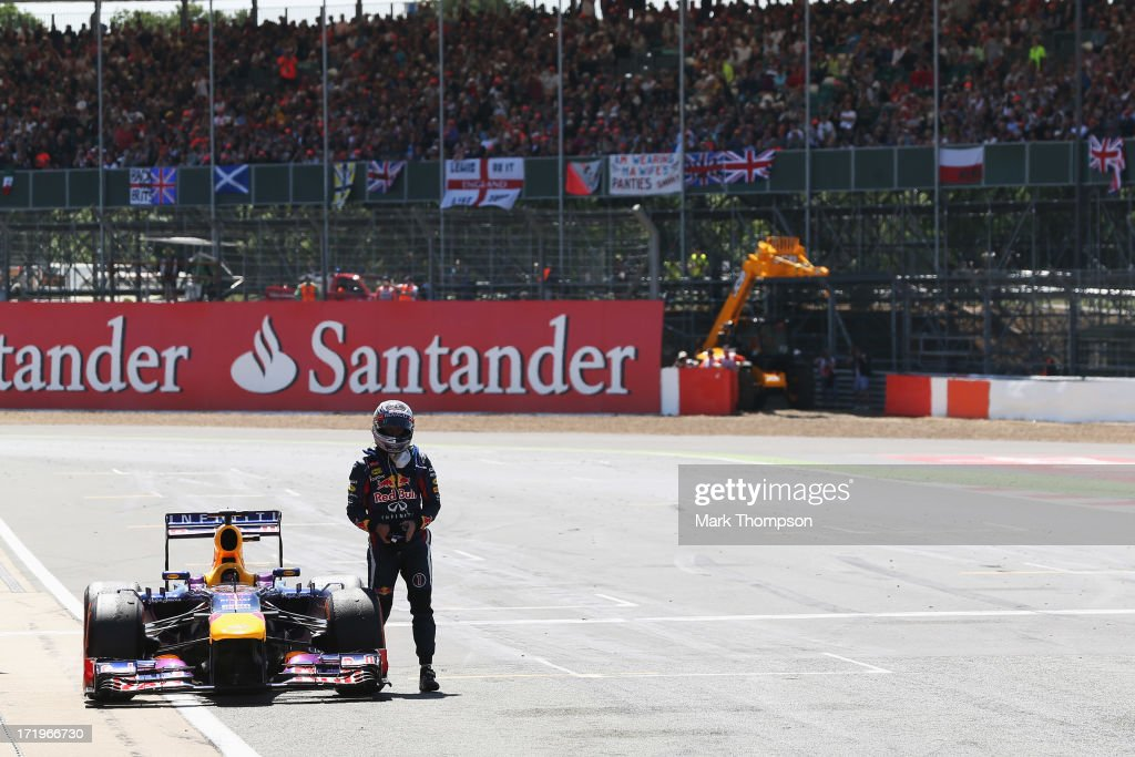 <a gi-track='captionPersonalityLinkClicked' href=/galleries/search?phrase=Sebastian+Vettel&family=editorial&specificpeople=2233605 ng-click='$event.stopPropagation()'>Sebastian Vettel</a> of Germany and Infiniti Red Bull Racing retires on the main straight with an engine failure during the British Formula One Grand Prix at Silverstone Circuit on June 30, 2013 in Northampton, England.