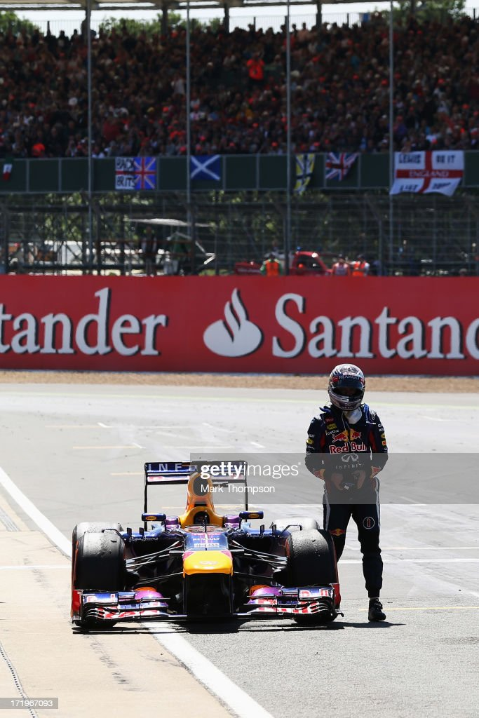 Sebastian Vettel of Germany and Infiniti Red Bull Racing retires on the main straight during the British Formula One Grand Prix at Silverstone Circuit on June 30, 2013 in Northampton, England.