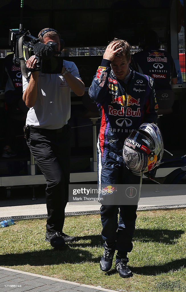Sebastian Vettel of Germany and Infiniti Red Bull Racing retires with an engine failure during the British Formula One Grand Prix at Silverstone Circuit on June 30, 2013 in Northampton, England.