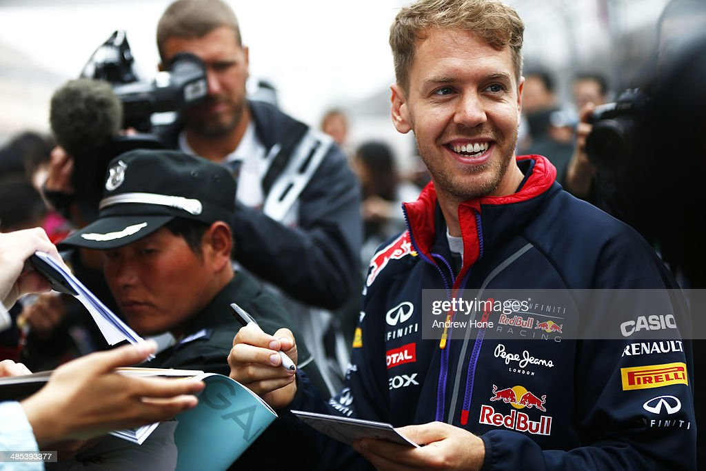 <a gi-track='captionPersonalityLinkClicked' href=/galleries/search?phrase=Sebastian+Vettel&family=editorial&specificpeople=2233605 ng-click='$event.stopPropagation()'>Sebastian Vettel</a> of Germany and Infiniti Red Bull Racing signs autographs ahead of the Chinese Formula One Grand Prix at the Shanghai International Circuit on April 17, 2014 in Shanghai, China.