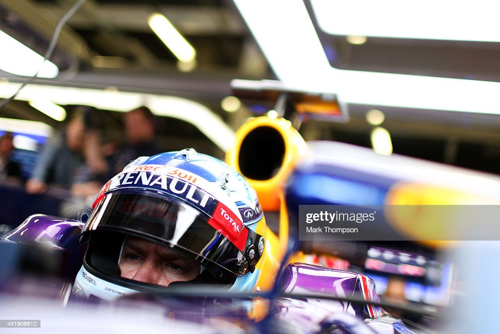 Sebastian Vettel of Germany and Infiniti Red Bull Racing sits in his car in the garage during day two of testing at Silverstone Circuit on July 9, 2014 in Northampton, England.