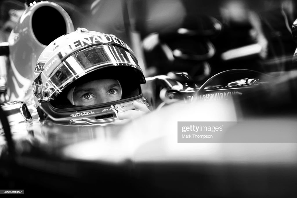 Sebastian Vettel of Germany and Infiniti Red Bull Racing sits in his car in the garage during practice ahead of the Belgian Grand Prix at Circuit de Spa-Francorchamps on August 22, 2014 in Spa, Belgium.