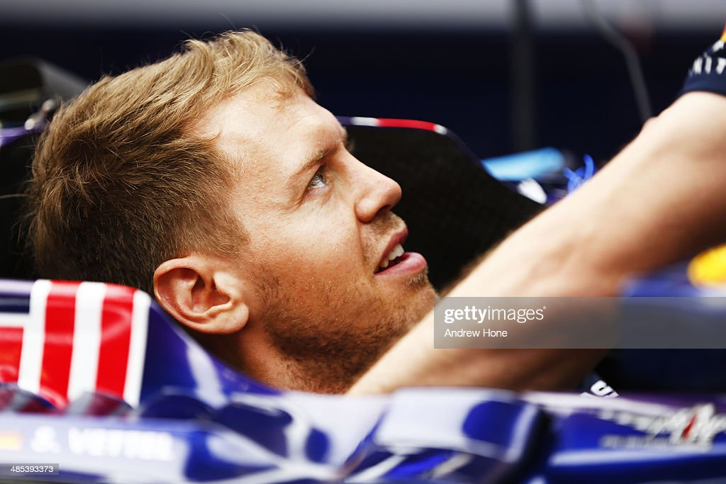 <a gi-track='captionPersonalityLinkClicked' href=/galleries/search?phrase=Sebastian+Vettel&family=editorial&specificpeople=2233605 ng-click='$event.stopPropagation()'>Sebastian Vettel</a> of Germany and Infiniti Red Bull Racing sits in his car ahead of the Chinese Formula One Grand Prix at the Shanghai International Circuit on April 17, 2014 in Shanghai, China.