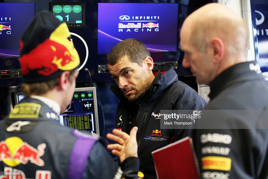 Sebastian Vettel of Germany and Infiniti Red Bull Racing speaks with Infiniti Red Bull Racing engineer Guillaume Rocquelin and Infiniti Red Bull Racing Chief Technical Officer Adrian Newey in the team garage during Formula One winter testing at Circuito de Jerez on February 7, 2013 in Jerez de la Frontera, Spain.