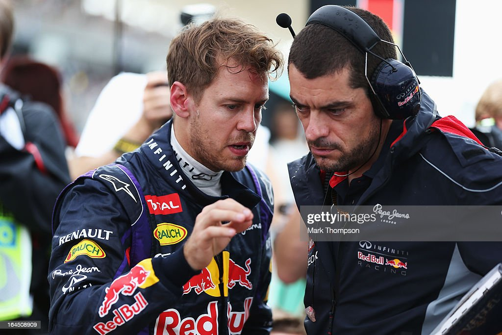 Sebastian Vettel of Germany and Infiniti Red Bull Racing talks with his race engineer Guillaume Rocquelin before the Malaysian Formula One Grand Prix at the Sepang Circuit on March 24, 2013 in Kuala Lumpur, Malaysia.