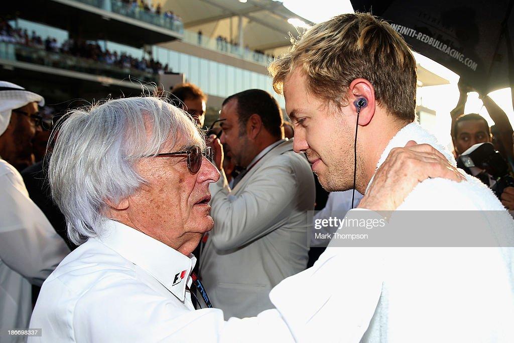 Sebastian Vettel of Germany and Infiniti Red Bull Racing talks with F1 supremo Bernie Ecclestone as he prepares to drive during the Abu Dhabi Formula One Grand Prix at the Yas Marina Circuit on November 3, 2013 in Abu Dhabi, United Arab Emirates.