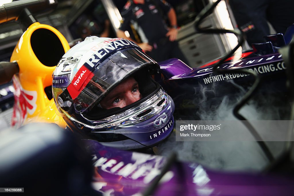 <a gi-track='captionPersonalityLinkClicked' href=/galleries/search?phrase=Sebastian+Vettel&family=editorial&specificpeople=2233605 ng-click='$event.stopPropagation()'>Sebastian Vettel</a> of Germany and Infiniti Red Bull Racing tries to keep cool as he prepares to drive during practice for the Malaysian Formula One Grand Prix at the Sepang Circuit on March 22, 2013 in Kuala Lumpur, Malaysia.