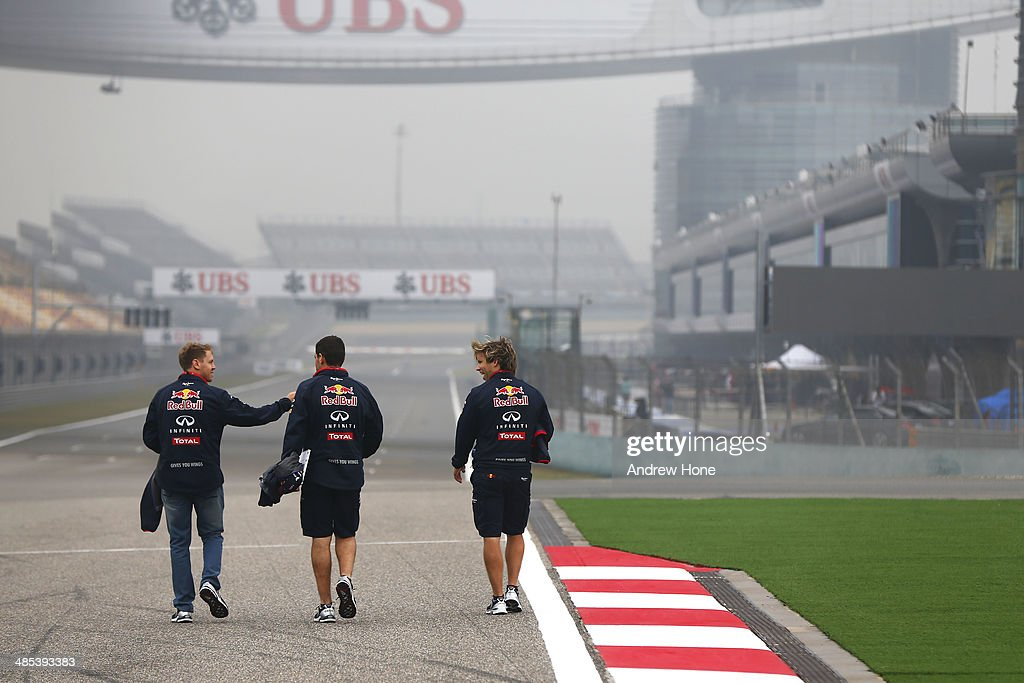<a gi-track='captionPersonalityLinkClicked' href=/galleries/search?phrase=Sebastian+Vettel&family=editorial&specificpeople=2233605 ng-click='$event.stopPropagation()'>Sebastian Vettel</a> (L) of Germany and Infiniti Red Bull Racing walks the track ahead of the Chinese Formula One Grand Prix at the Shanghai International Circuit on April 17, 2014 in Shanghai, China.