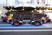Sebastian Vettel of Germany and Mark Webber of Australia pose with Red Bull Racing team mates for an end of season photograph during previews for the...