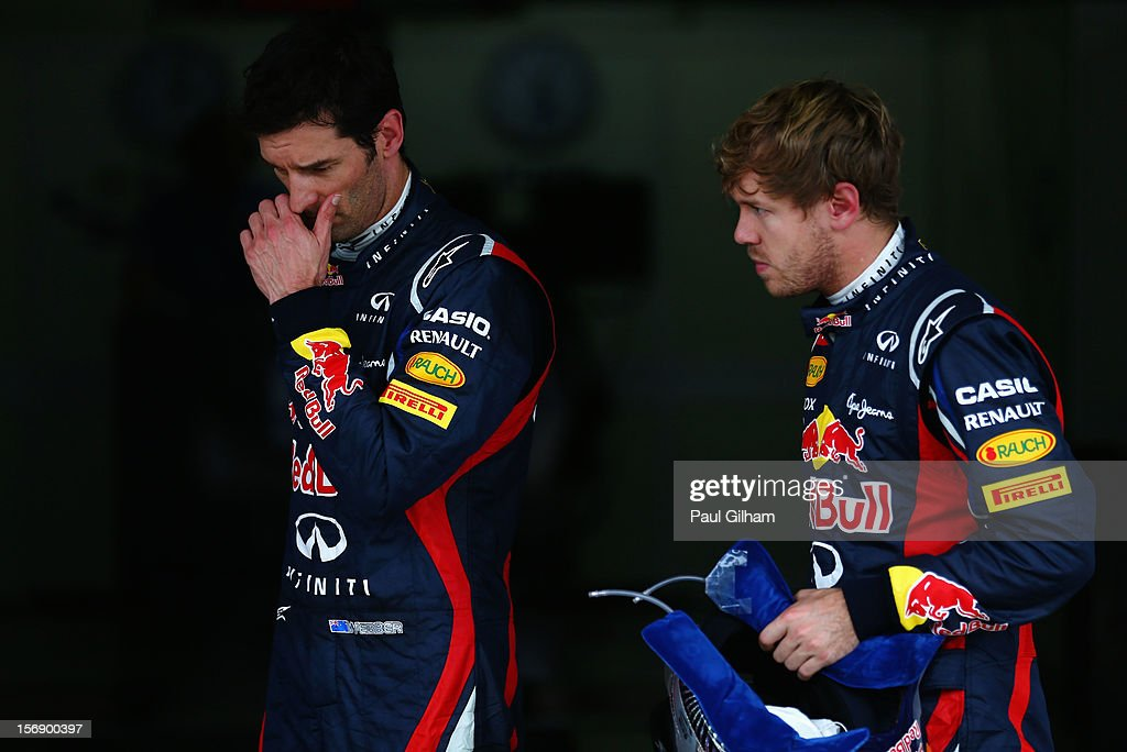 <a gi-track='captionPersonalityLinkClicked' href=/galleries/search?phrase=Sebastian+Vettel&family=editorial&specificpeople=2233605 ng-click='$event.stopPropagation()'>Sebastian Vettel</a> (R) of Germany and Red Bull Racing and <a gi-track='captionPersonalityLinkClicked' href=/galleries/search?phrase=Mark+Webber+-+Racerf%C3%B6rare&family=editorial&specificpeople=167271 ng-click='$event.stopPropagation()'>Mark Webber</a> (L) of Australia and Red Bull Racing react in parc ferme following qualifying for the Brazilian Formula One Grand Prix at the Autodromo Jose Carlos Pace on November 24, 2012 in Sao Paulo, Brazil.