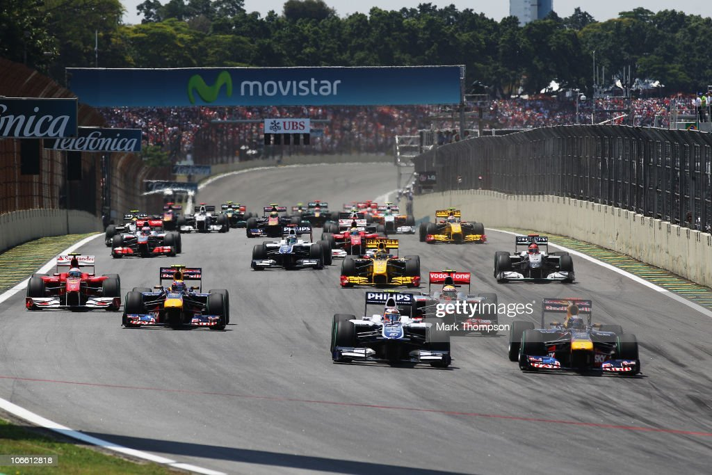 <a gi-track='captionPersonalityLinkClicked' href=/galleries/search?phrase=Sebastian+Vettel&family=editorial&specificpeople=2233605 ng-click='$event.stopPropagation()'>Sebastian Vettel</a> (right) of Germany and Red Bull Racing beats Nico Huelkenberg (2nd right) of Germany and Williams into turn one at the start of the Brazilian Formula One Grand Prix at the Interlagos Circuit on November 7, 2010 in Sao Paulo, Brazil.