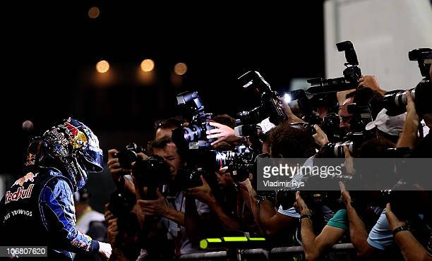 Sebastian Vettel of Germany and Red Bull Racing celebrates after qualifying for the Abu Dhabi Formula One Grand Prix at the Yas Marina Circuit on...