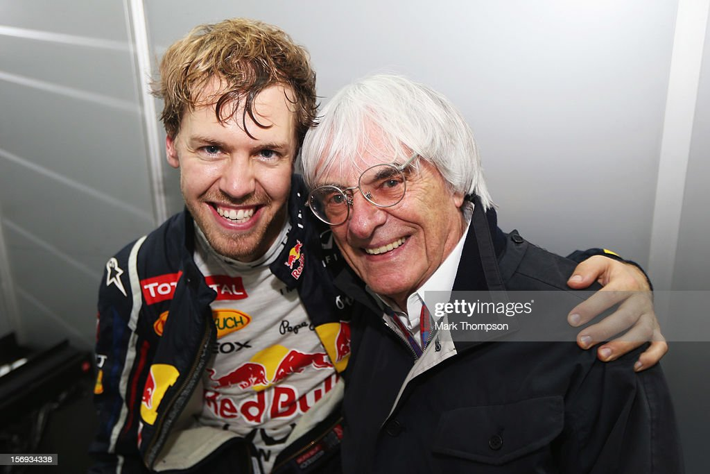 Sebastian Vettel of Germany and Red Bull Racing celebrates in his changing room with F1 supremo Bernie Ecclestone as he finishes in sixth position...