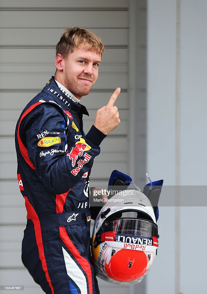 <a gi-track='captionPersonalityLinkClicked' href=/galleries/search?phrase=Sebastian+Vettel&family=editorial&specificpeople=2233605 ng-click='$event.stopPropagation()'>Sebastian Vettel</a> of Germany and Red Bull Racing celebrates in parc ferme after finishing first during qualifying for the Japanese Formula One Grand Prix at the Suzuka Circuit on October 6, 2012 in Suzuka, Japan.