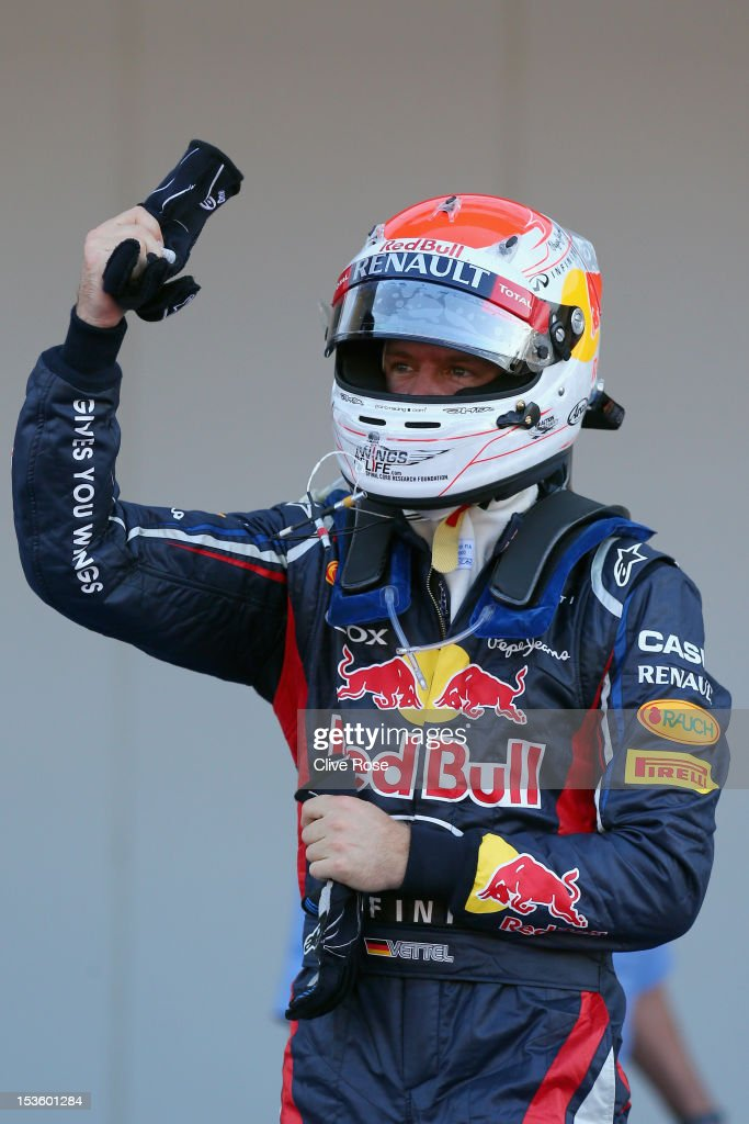 <a gi-track='captionPersonalityLinkClicked' href=/galleries/search?phrase=Sebastian+Vettel&family=editorial&specificpeople=2233605 ng-click='$event.stopPropagation()'>Sebastian Vettel</a> of Germany and Red Bull Racing celebrates in parc ferme after winning the Japanese Formula One Grand Prix at the Suzuka Circuit on October 7, 2012 in Suzuka, Japan.
