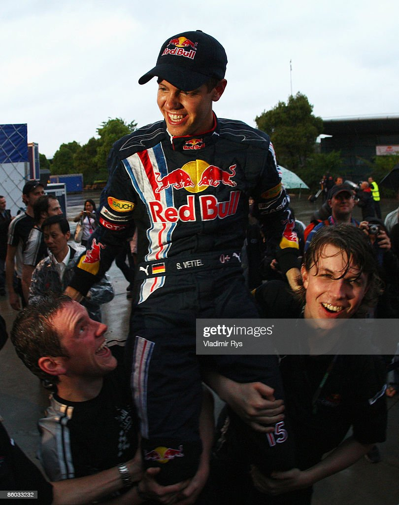 Sebastian Vettel of Germany and Red Bull Racing celebrates in the paddock after winning the Chinese Formula One Grand Prix at the Shanghai...